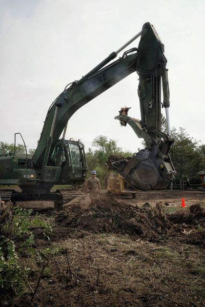 188th Engineer Company removing trees with an excavator