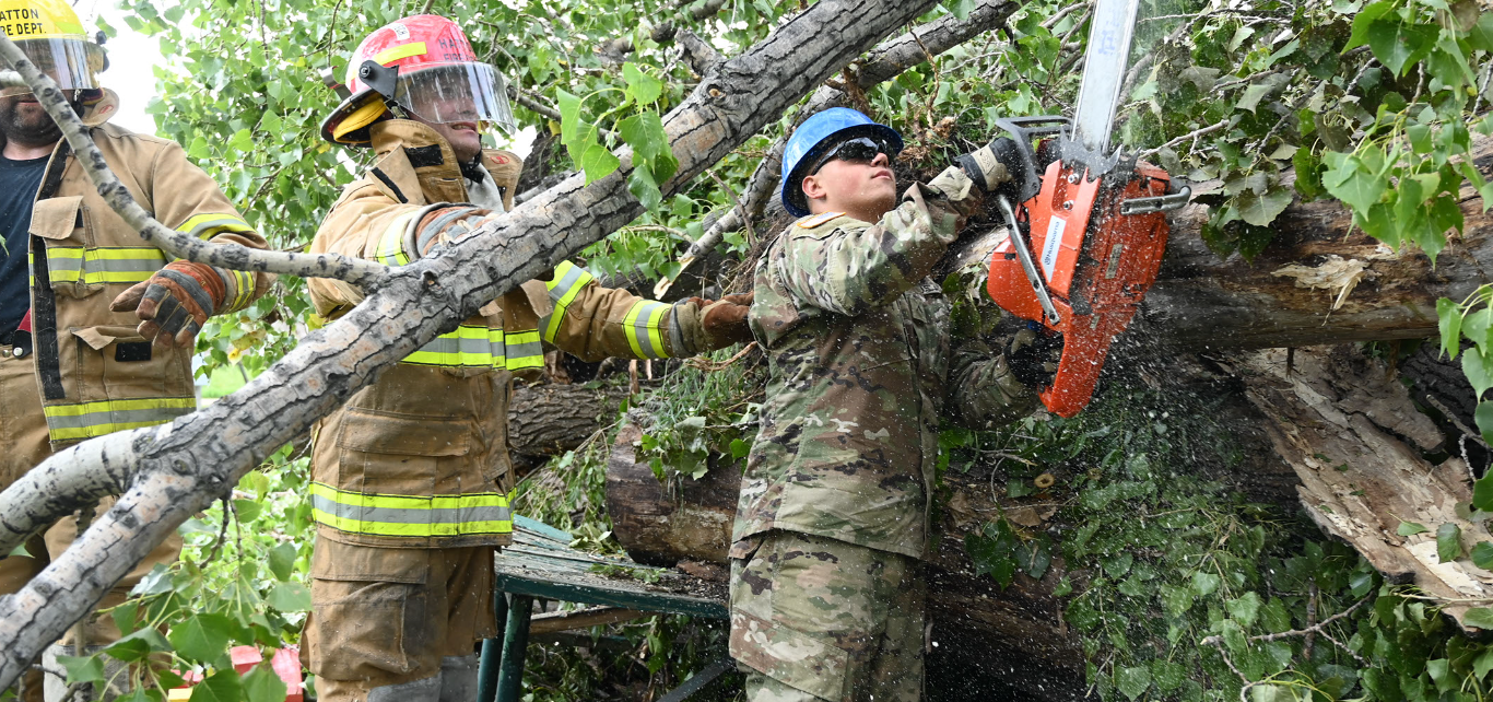 Pvt. Seth Horn, of the 188th Engineer Company, uses a chainsaw to remove branch limbs that are blocking rescue access to a simulated victim during Exercise Vigilant Guard at Golden Lake, N.D., Aug. 5, 2020. (Air National Guard photo by Chief Master Sgt. David H. Lipp)